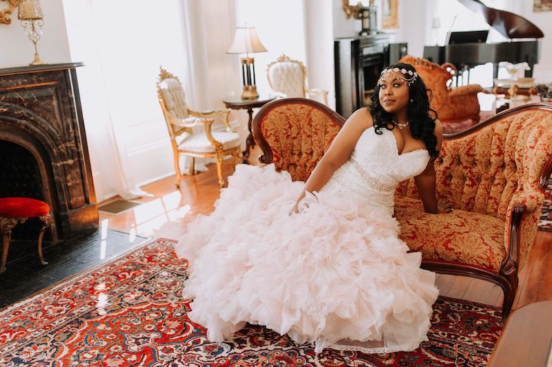 Bride wearing an Allure Wedding Dress