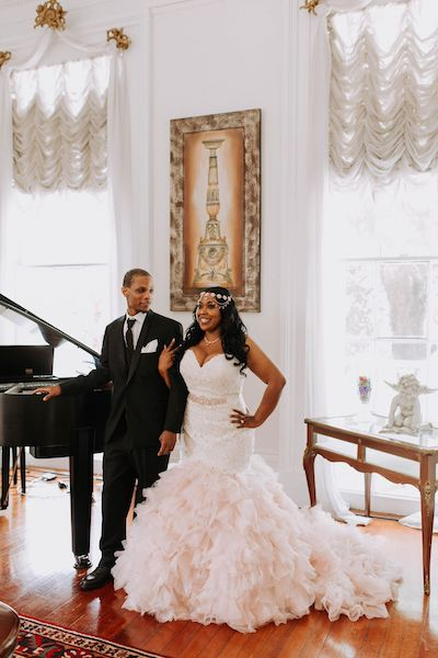 Bride and Groom next to a Grand Piano