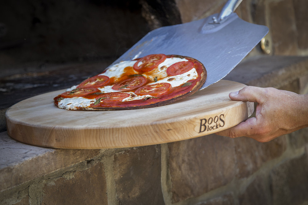 "John Boos Cutting boards - John Boos has an awesome line of gourmet products and foodservice equipment. We are huge fans of their cutting boards. They last forever, and there is one available for all your needs. This Round Reversible Board is perfect for pizzas. It measures 18"" around and is 1.5"" thick. You can use both sides, and it is made of hard rock maple. We never have to search for a pan to cut and serve pizza any more.Our other favorite board is their Au Jus Maple Cutting Board. This board has a sloped, wide groove and well that makes this board perfect for cutting meats and using it for BBQing. It's made of solid maple and has a natural oil finish. And, their boards are made in the US! Make sure to grab their mystery oil and board creme to care for these boards, and you'll be using them for years to come."