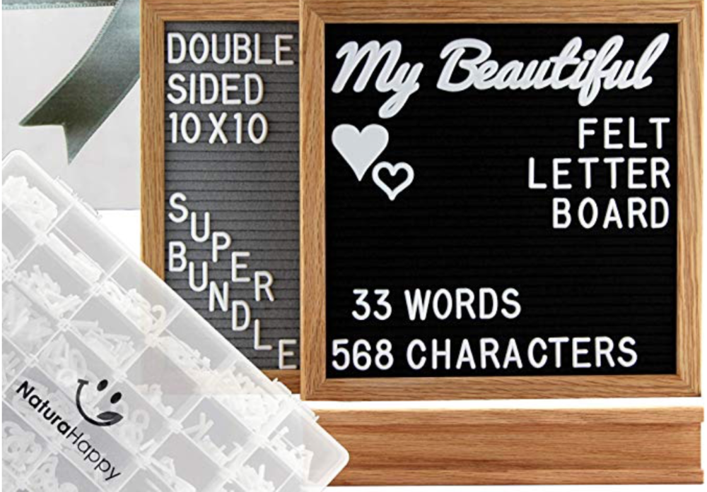 "Double Sided Felt Letter Board by NaturaHappy - Letter Boards are all the rage lately, and NaturaHappy has one of the best! You actually get 2 letter boards in 1! This Board measures 10x10"" with one grey side and one black side. It also comes with 601 White Plastic Letters, with words, emojis, and symbols…and even includes an organizer storage box too! Plus it comes with a stand as well. It's the whole package. They also have 2 great add-on packages. The first comes with 381 White Plastic Letters including 1 Inch Characters, Cursive Words, Hearts, Symbols, and the second set comes with 271 White Plastic Letters including 3/4 Inch Characters, Cursive Words, Emojis & Icons. You can have the whole pack! And it's available on PRIME! What more could you want?! Click on each picture for more details. Grab this awesome set for every lady on your list!"