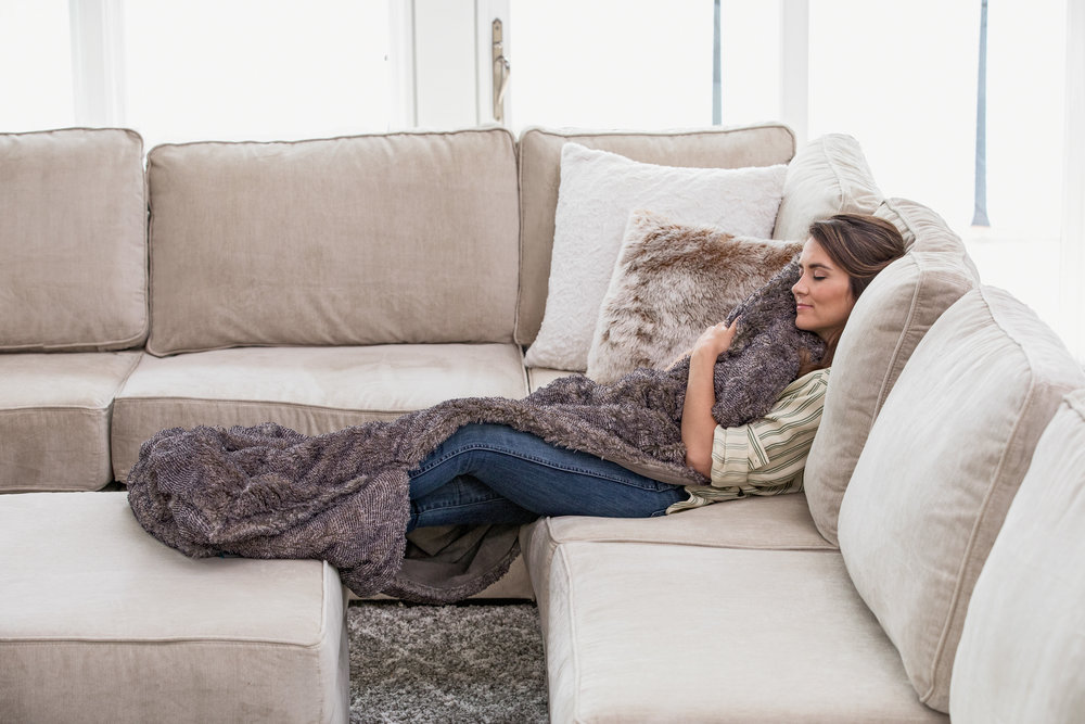 "Footsac Blanket: Eskimo Swirl Phur - This blanket from Lovesac is sure to be your new favorite. It's not only a super soft blanket, but it also has a special pocket for your feet! No more fighting to keep your toes warm, this blanket has you covered! (pun intended) The foot pocket is 18"", so it's a good size to tuck both feet in, and cover up. The blanket measures 50"