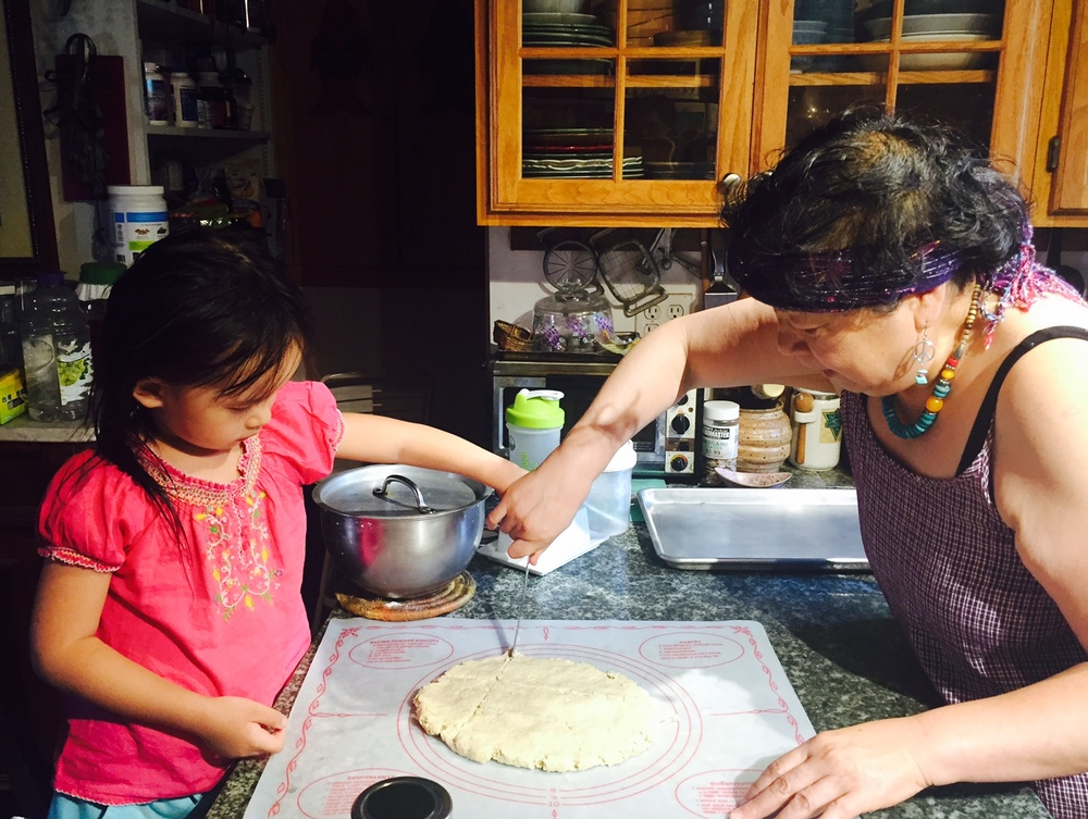 Limin and Phoenix cut biscuits.jpg