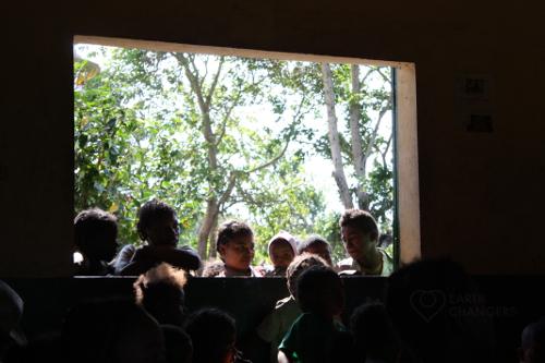 Madagascar kids crowd to the St Luce school window