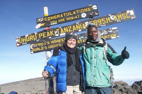 in support of local travel guides: On the summit of kilimanjaro, 2009