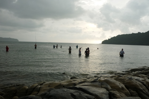 I loved this: bamboo rod fishing in the south china sea in the rain with borneo locals