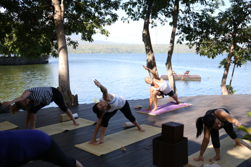 on Jicaro Island's deck, stretch into wellness in Yoga classes
