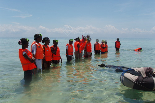chumbe island coral park teaches girls marine conservation & to snorkel & swim