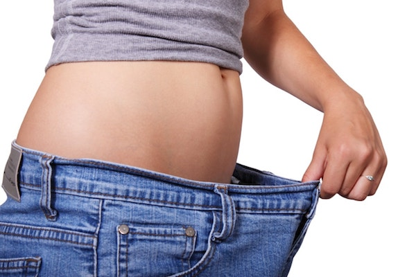 picture of white woman in jeans with belly showing weight loss
