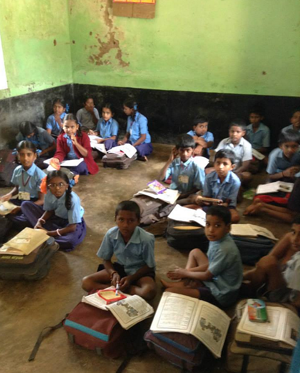 Indian Children sitting on the floor at school.png