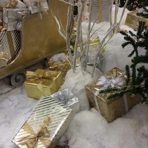 A close up of our presents nestled in snow.