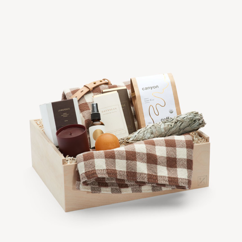 Simone Le Blanc Gift Box – California Canyon Deluxe    Price: $348   This carefully curated gift box is perfect for the free spirited person in your life. Complete with candles, soaps, decadent chocolates and more, this gift is serenity in a box.