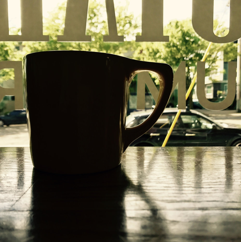 This lone yellow ceramic Royal Drummer coffee cup needs a friend. It could be you, enjoying a delicious R.D. coffee offering.