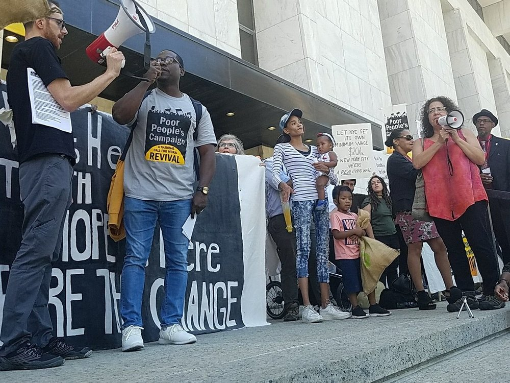 Demond Meeks speaking in front of the Legislative Office Building.