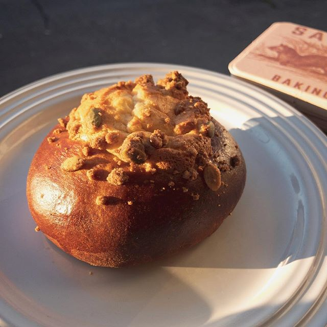 Mornin' - -we sold out of the bread but still plenty of pastries and coffee! Including this pumpkin brioche filled with cream cheese filling and sprinkled with pepita streusel. C'mere!