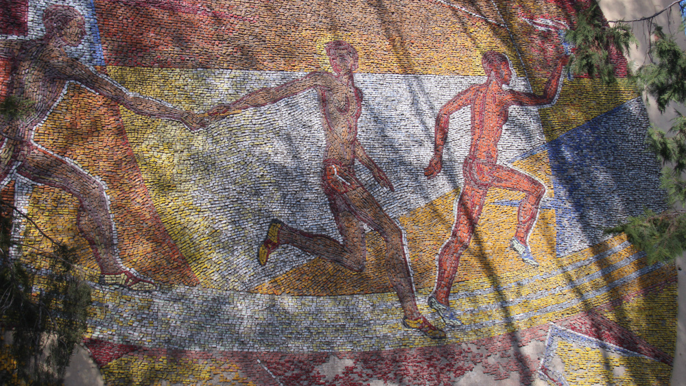 Momunbek Akmatkulov's 'Sports, sports' mosaic is located on the wall of the National Olympic Reserve on Kolbaev str.