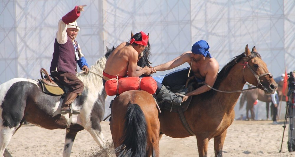 - In this competition there are two horse-riding wrestlers stripped to the waist, each with a whip in hand. To win one drag down an opponent off his horse, so that the other athlete touches the ground with any part of the body.