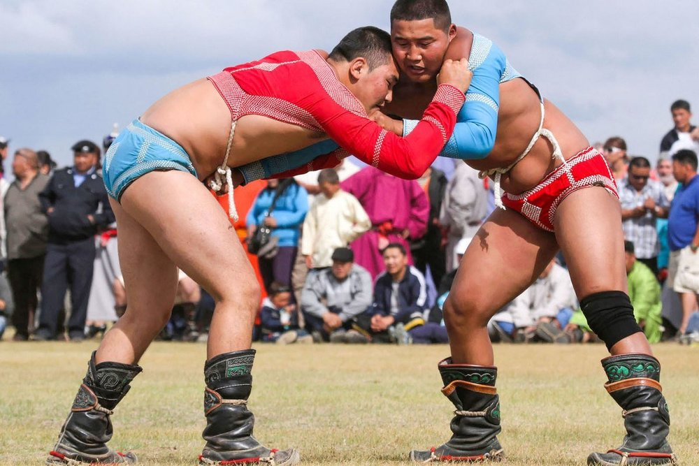 - Mongolian wrestling allows holds, jerks, pushes to unbalance an opponent, throws, including with the use of legs, and reaps. In order to win one needs to make the opponent touch the ground with any part of the body from the knee and above.