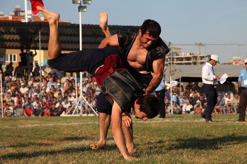 - Turkish wrestling with any holds of the opponent's body and clothes. To win you have to throw your opponent on his back or to make him touch the ground with his stomach.