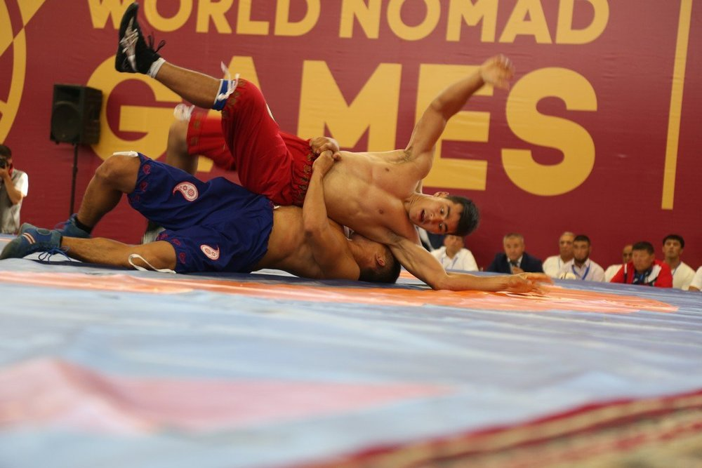 - Azerbaijani national wrestling. Holds are of the body, legs, waist and any part of trousers. In order win one has to press the opponent flat on his back to the mat.