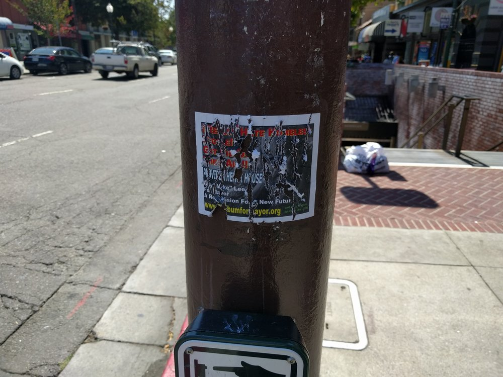 A defaced ad for Mike Lee in Downtown Berkeley