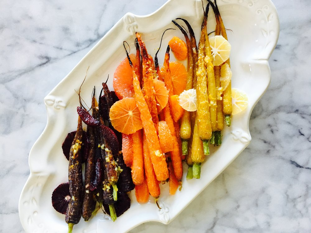 When winter is almost over and spring is on it's way, this dish is the perfect blend of the seasons as they change. The winter citrus season is coming to a close and spring is arriving with beautifully colored carrots.
