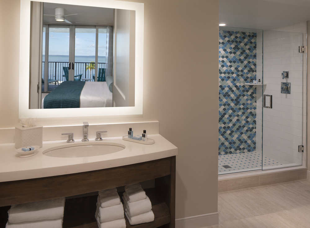 The Laureate Key West bathroom with shower and sink