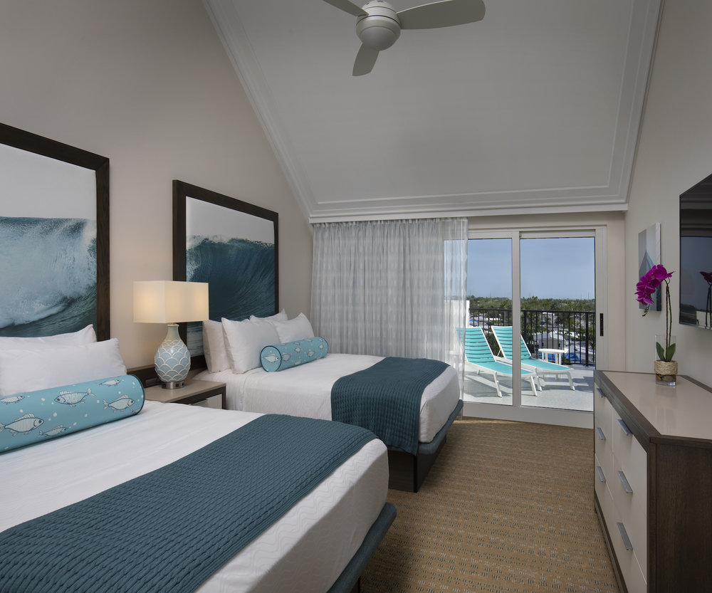 The Laureate Key West two queen bed guest room with balcony