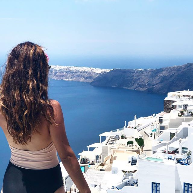 Enjoying our time in Greece on our honeymoon! 🇬🇷 I can't wait to share some travel guides and frugal swimsuits with y'all from our time on the islands! (This is the romantic little village of Imerovigli that we stayed in during our visit to Santorini. 😍) #santorinigreece #travelstyle #honeymoon #greekislands #vacationstyle