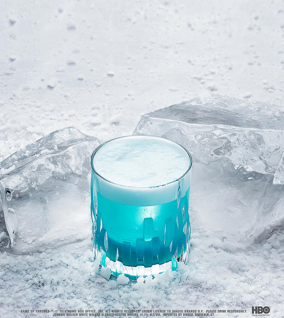 THE NIGHT KING'S SOUR WHITE WALKER SCOTCH WHISKY COCKTAIL    - 1. Add 1 oz White Walker by Johnnie Walker Scotch Whisky, 0.5 oz Blue Curacao, 0.5 oz lemon juice, 0.5 oz white grape juice, 0.5 vanilla syrup, and 1 egg white into a shaker 2. Add ice and shake vigorously  3. Strain into a rocks glass 4. Garnish as desired