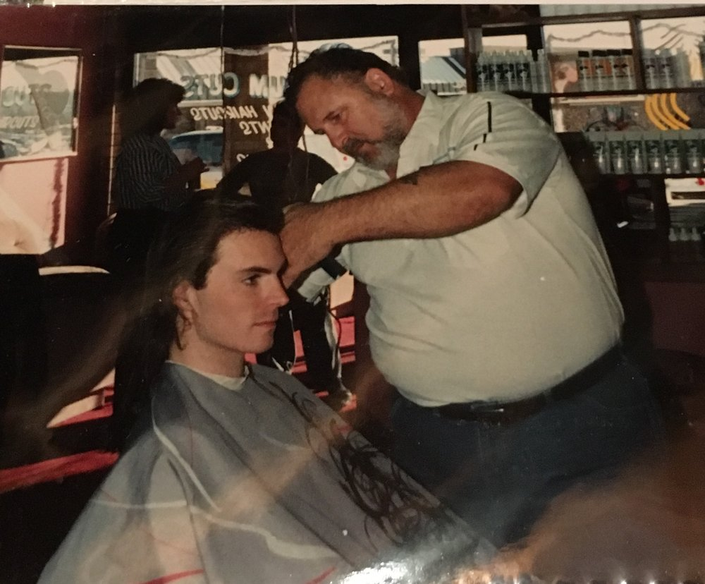 "My pal Joe cutting my locks, ca. 1990.    My Mama took the pic.   This is my ""I would prefer a beating"" look."