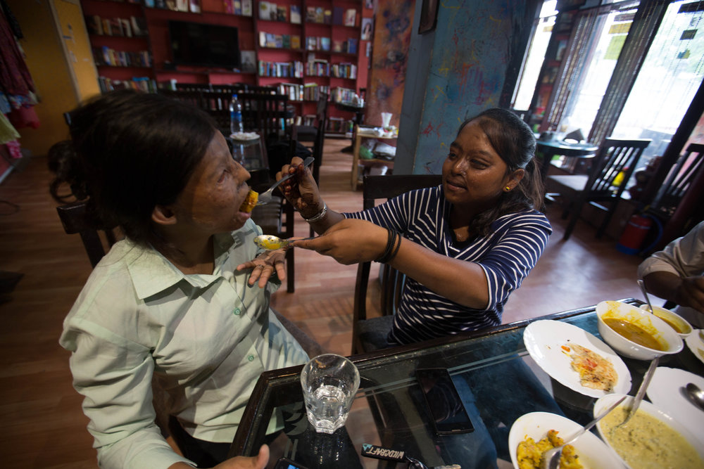 Rupa accepts a bite from Dolly at Sheroes' Hangout on June 12, 2016.