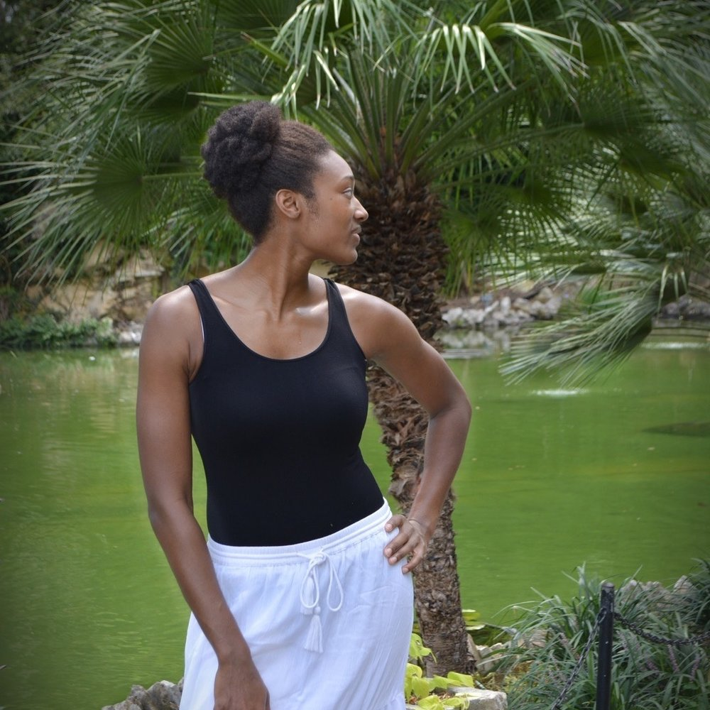 Talltique black tank top, perfect to pair with a skirt or pants!