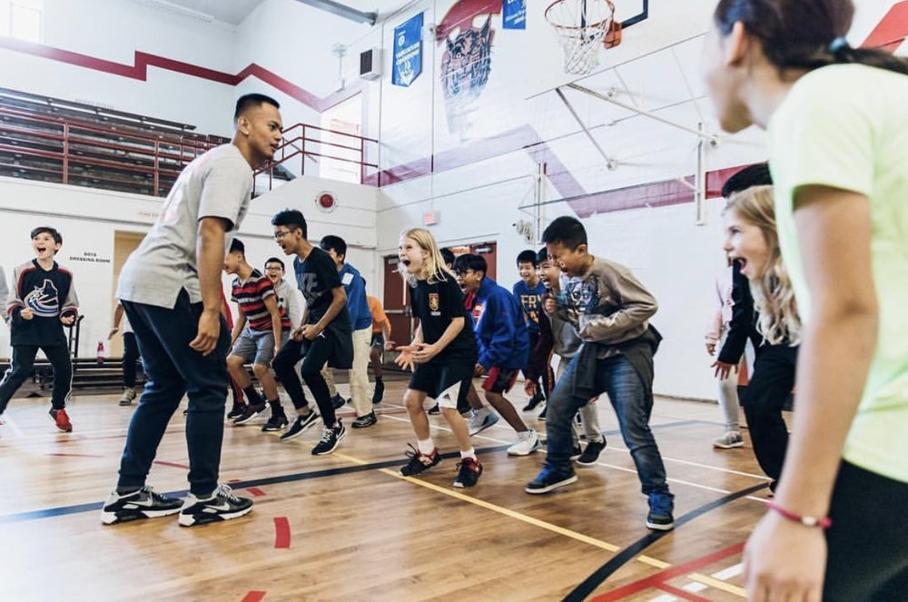 Christian in his element, sharing his love of the game with the kids! Photo courtesy of NBA Canada.
