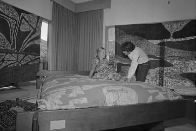 A young woman listens to a pitch from a waterbed salesman.  (Image credit: Bettmann/Getty Images)