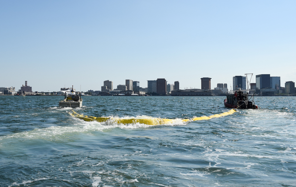 "The Sea Machines Prototype, ""507"", is seen left towing oil boom in collaboration with a manned boat, at right, in Boston Harbor in July 2016"
