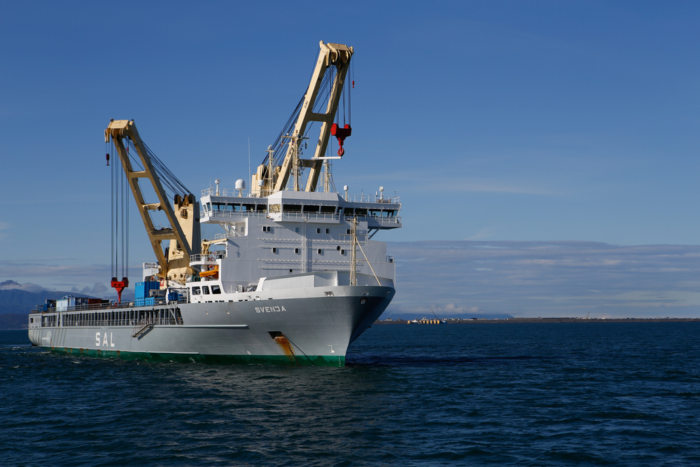 The SVENJA is seen using both her cranes while at anchor in the Cook Inlet, just off Home, in Alaska
