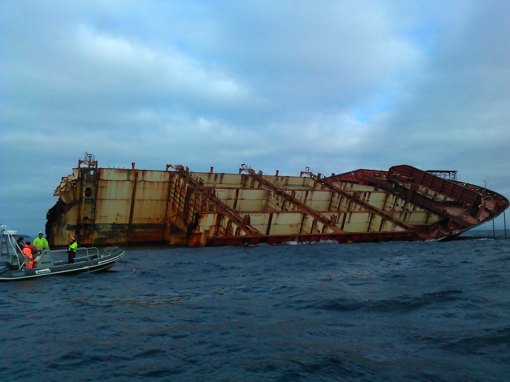 A more recent photo of the RENA, with all her containers removed, but still broken in half and hard aground