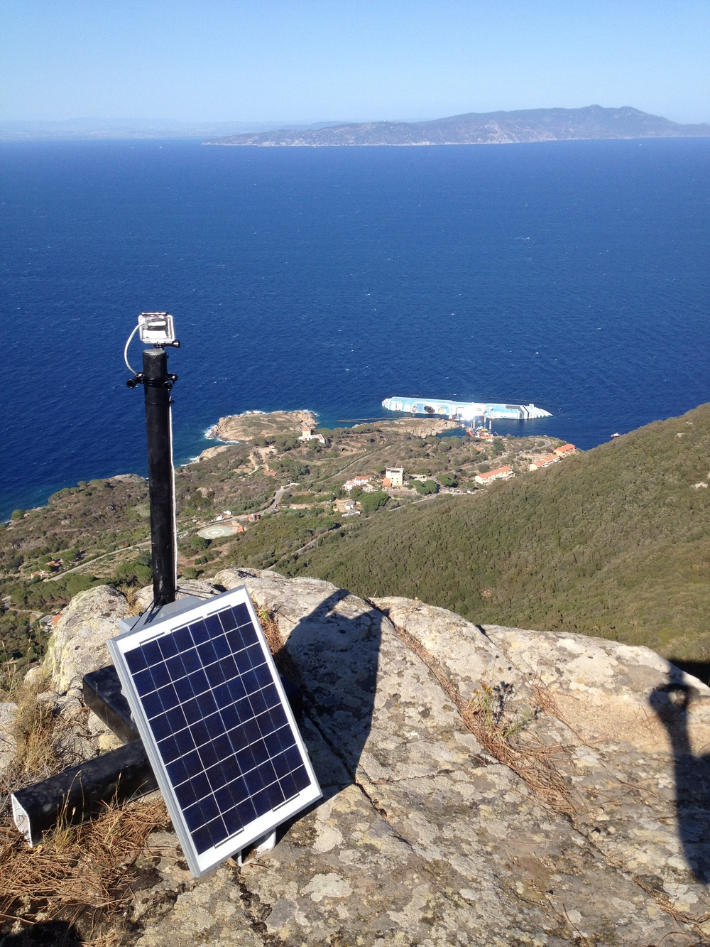 One of my solar powered time lapse rigs in position watching over the wreck of the COSTA CONCORDIA