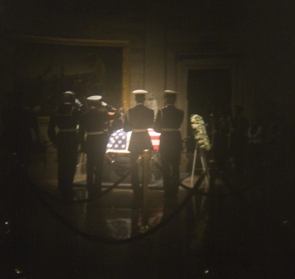 The casket of President Ford is seen lying in state, protected by a military honor guard, in the United States Capital rotunda. - Alex Lorman