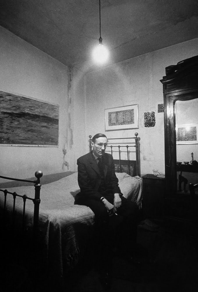 william-burroughs-on-bed-in-beat-hotel.1959.jpg