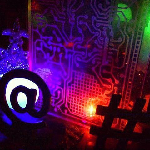 Hacktivist Village #led #lasercut #laseretched #acrylic #artinstallation #sculpture #hacker #hackspace #electronics #art🎨 #laser #lights #glow #computer #techart #festival #digitalart #interactiveart #digitalculture #neon #ravers #cyberpunk #tech #futuristic #makerspace