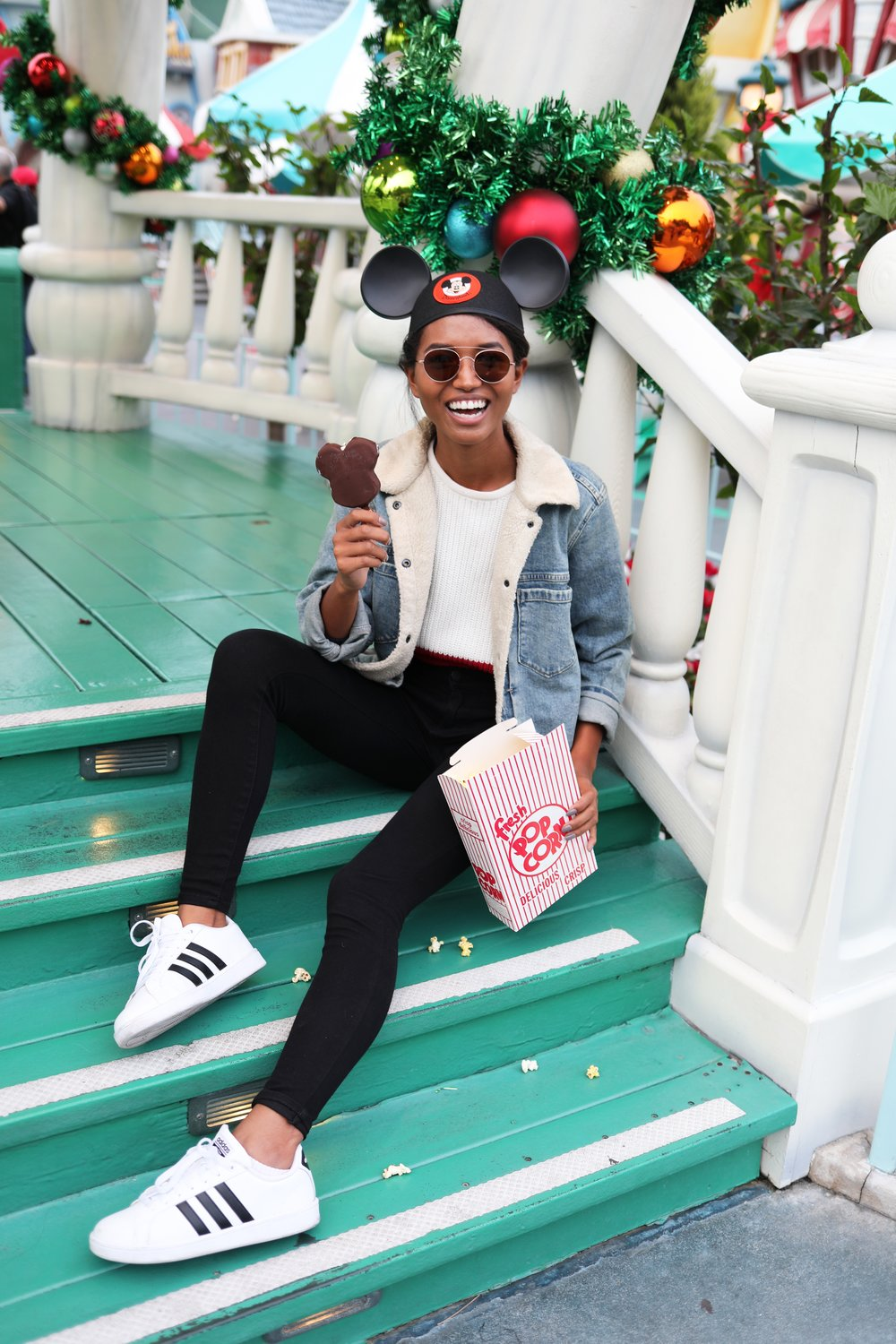 Nikki wearing the kensie 'inside out' while snacking on some Disney treats in Toon Town!