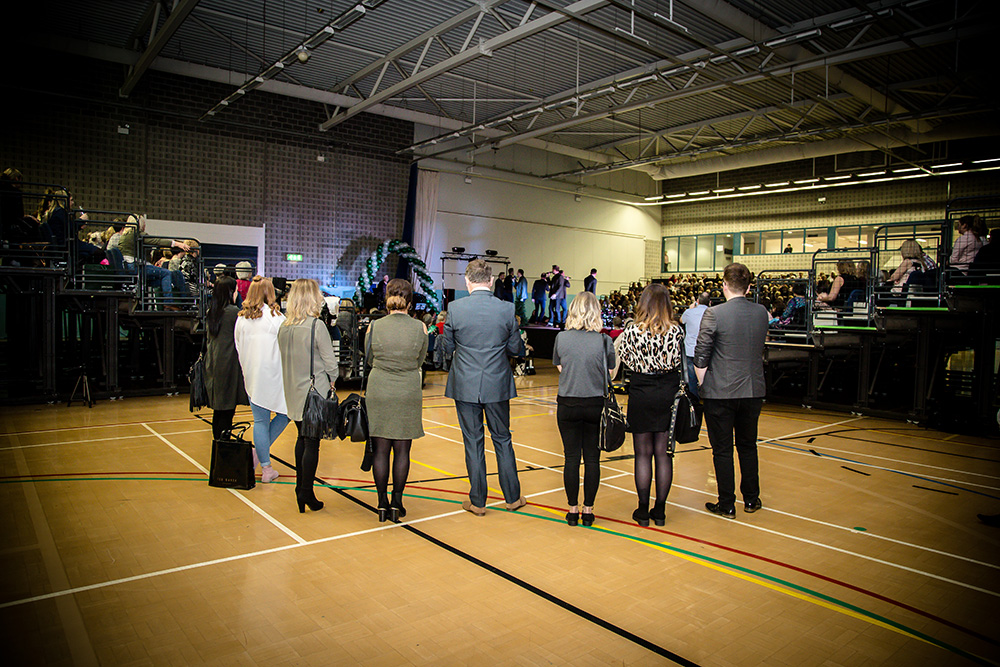 The team looks on at Macmillan charity fashion event