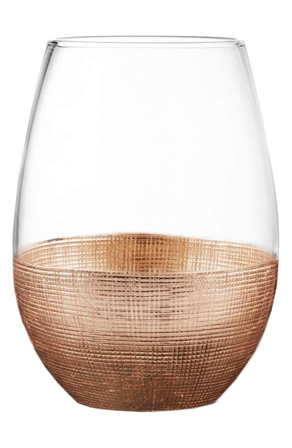 America Atelier Linen Wine Glasses - By far the coolest wine glasses I've ever seen, these stemless wine glasses have a crosshatched metallic base and comes in copper (pictured) or gold.$40 for a set of 4.