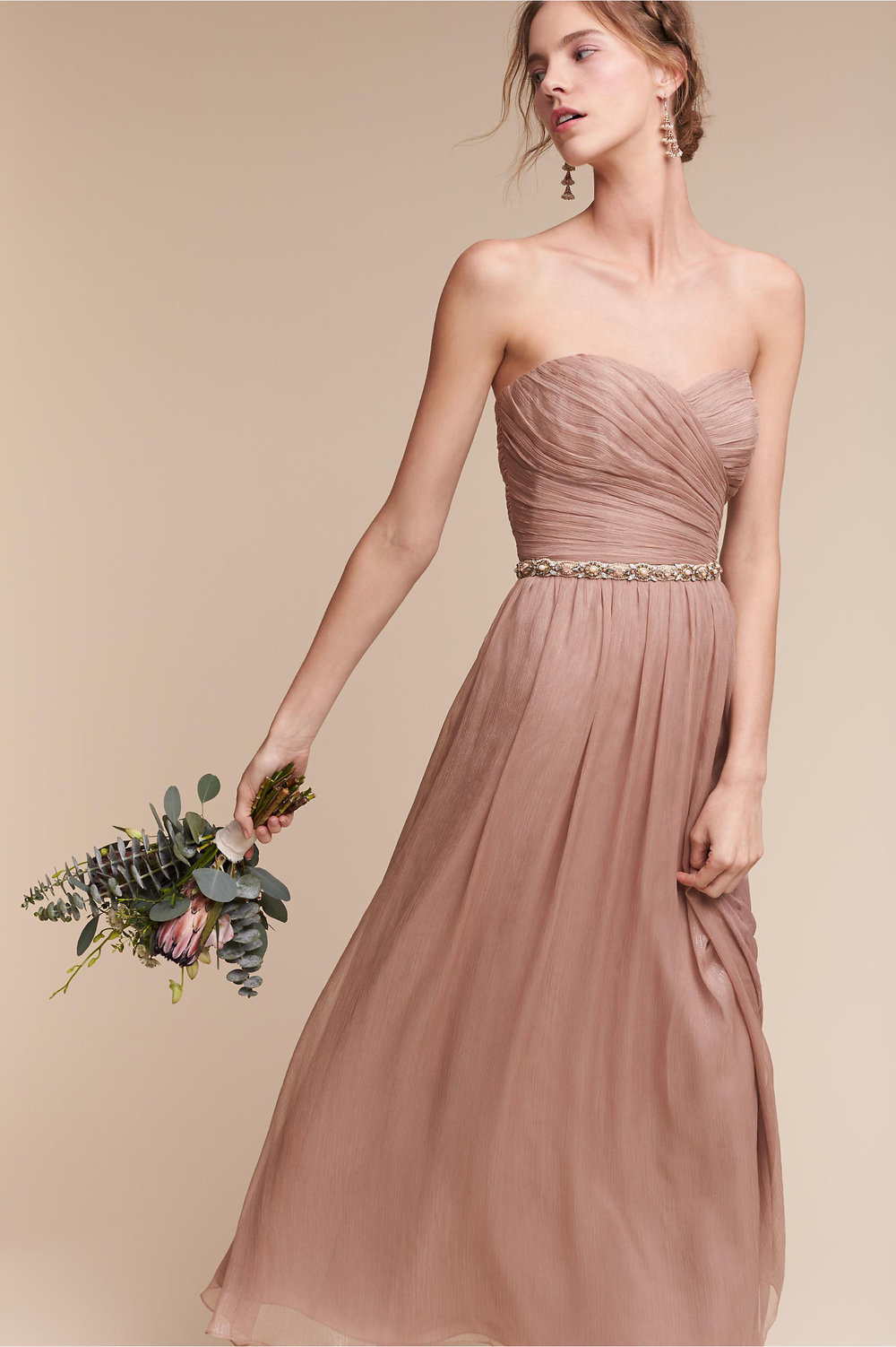 Della Dress - This dress is so flattering and romantic, and an absolute steal right now on BHLDN. Ruched bodices are always flattering, but the beauty of this strapless lies in its skirt; the midi-length allows for maximum movement while the shimmer fabric catches the light in the most beautiful way.Price: Retail $350, now just $120 (move fast on this one! limited sizes available).