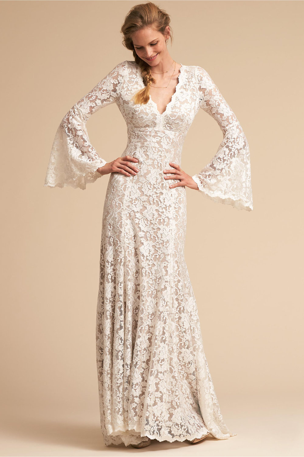 Lucca Gown - Seriously, BHLDN for the win! If you're a boho-bride, this dress would be a perfect (and completely stunning) option. Cut from intricate floral lace, this dress has an insane back cutout that will give your guests something pretty to look at while you're saying