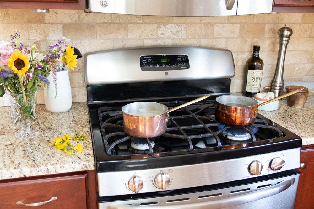 Copper pots simmering away