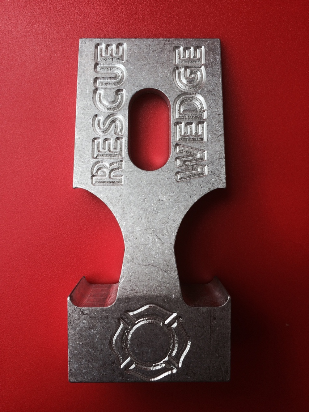 "RESCUE WEDGE - 1 3/4 INCH   Specifications: At only 4.3 ounces, The Rescue Wedge is extruded from aluminum alloy. The tool is 4"" long x 1.75"" wide x .966"" declining height.  Made in the USA.   COST: $30.00"