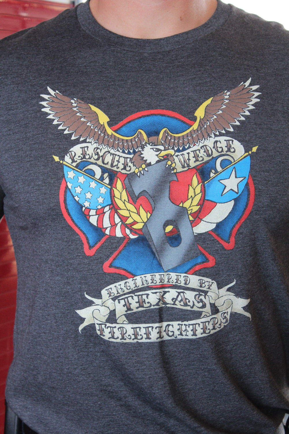 Rescue Wedge - T-shirt   This high quality tri-blended charcoal t-shirt features our logo, the American Eagle grasping the Rescue Wedge with its sharp talons. Designed by Caitlin Hamby, the shirt comes in multiple sizes.   COST: $25.00