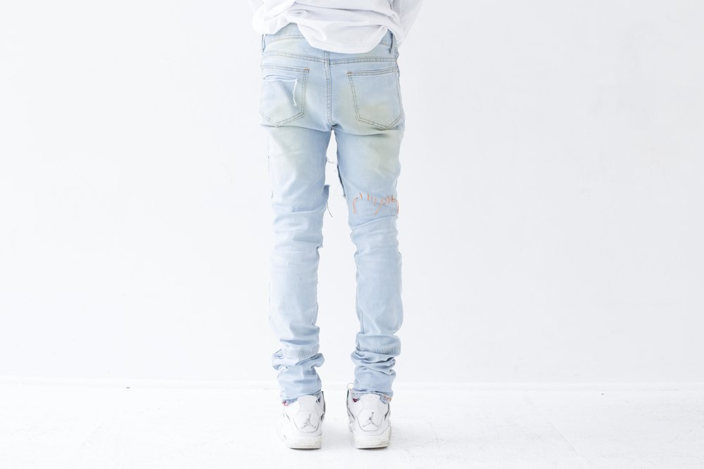 nextlvlhigh scab jeans on body back.jpg